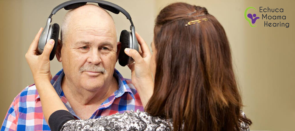 Old man having hearing test performed in Echuca