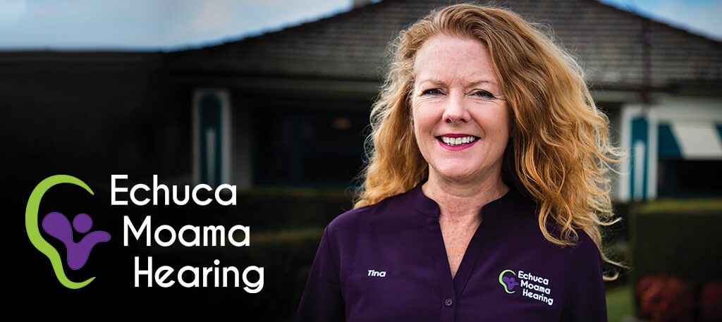 Tina Dennet standing in front of Echuca Moama Hearing clinic offices